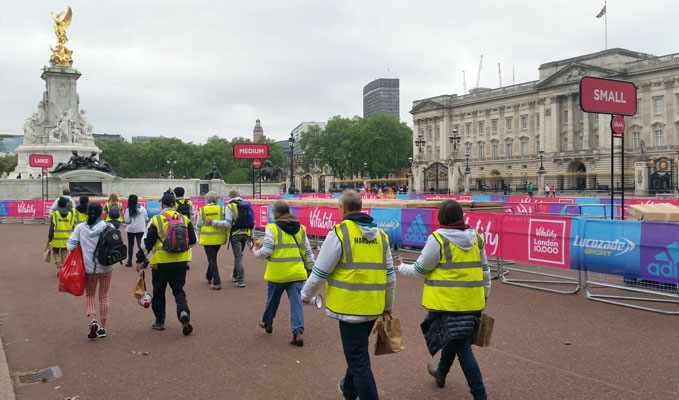 Vitality 10000 marshals walking past Buckingham palace